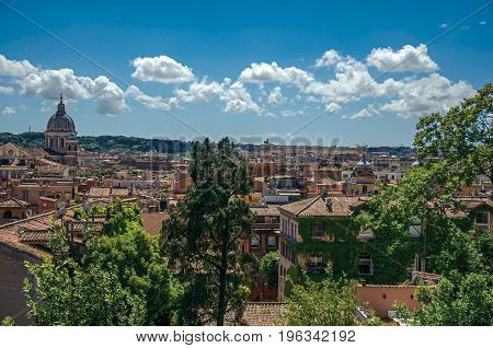 Overview of cathedrals domes and roofs of buildings on a sunny day in Rome, the incredible city of the Ancient Era, known as