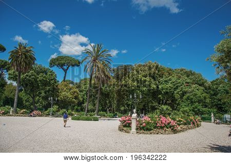 View of square and grove in the Villa Borghese park on a sunny day in Rome, the incredible city of the Ancient Era, known as