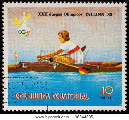 Moscow Russia - July 20 2017: A stamp printed in Equatorial Guinea shows competitions in academic rowing series