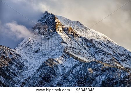 Fresh snow on a sunlit mountain peak in the Canadian Rockies British Columbia Canada after a snow storm.