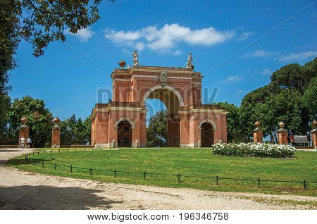 View of the unusual facade of theater in the Villa Pamphili Park on a sunny day in Rome, the incredible city of the Ancient Era, known as