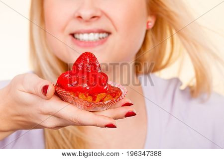 Woman Holding Sweet Strawberry Cupcake
