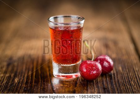 Portion Of Cherry Liqueur On Wooden Background, Selective Focus