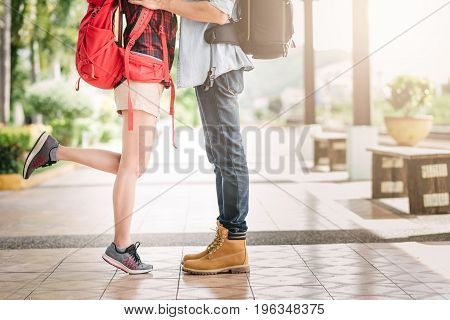Close up leg of young couple traveler kissing outdoor at train station