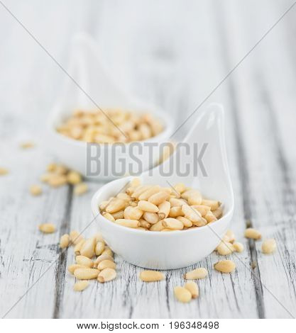 Portion Of Pine Nuts On Wooden Background (selective Focus)