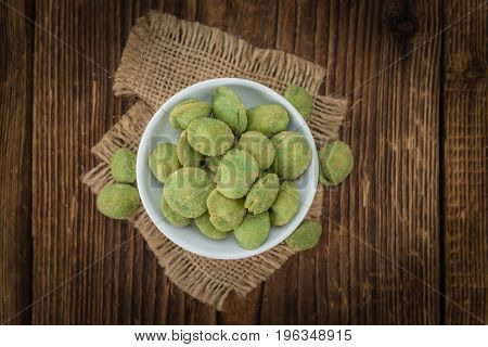 Peanuts (with Wasabi Flavor) On Vintage Wooden Background