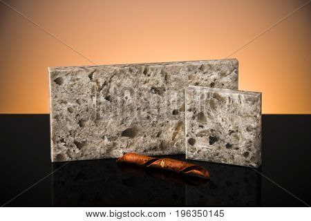 Elegant stone samples of kitchen and bathroom countertops stands on black surface