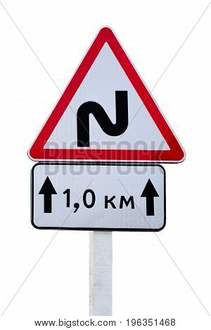 Winding road sign and a pointer 1 km isolated on white