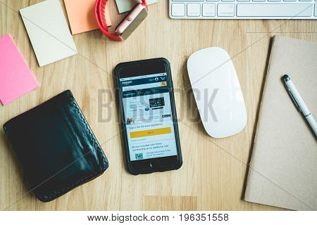 Chiang Mai Thailand - July 21 2017 An iphone 6 on a table with a keyboard and mouse. Open on the phone is the Amazon shoping application