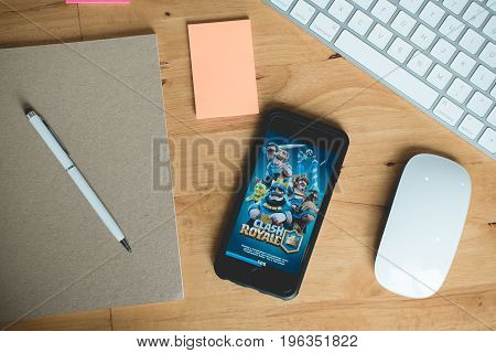 Chiang Mai Thailand - July 21 2017 An iphone 6 on a table with a keyboard and mouse. Open on the phone is the clash royale application
