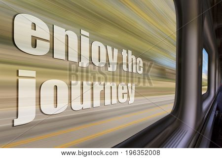 enjoy the journey inspirational phrase against a blurred  landscape as seen from a  train window in motion