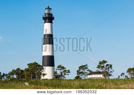 Bodie Island lighthouse and surrounding buildings on the Outer Banks of North Carolina near Nags Head.