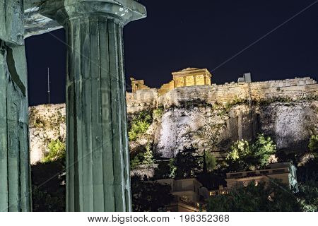 entrance of roman agora athens greece, acropolis in far view