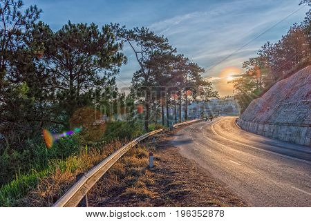 Beautiful road through the mountain the forest at sunrise