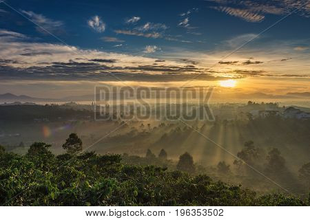 Beautiful landscape with fog and sunlight in the mountains