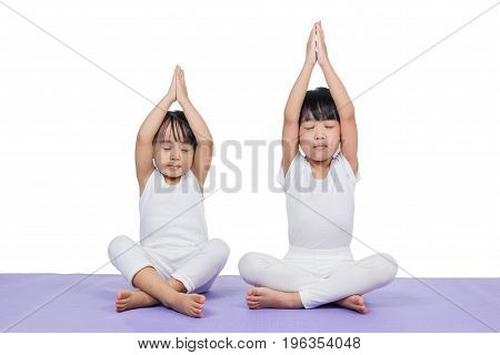 Asian Chinese Little Girls Practicing Yoga Pose