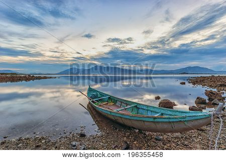 Lonely, wooden boat in the peaceful lake