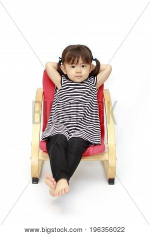 Japanese Girl Sitting On The Chair (2 Years Old) (white Back)