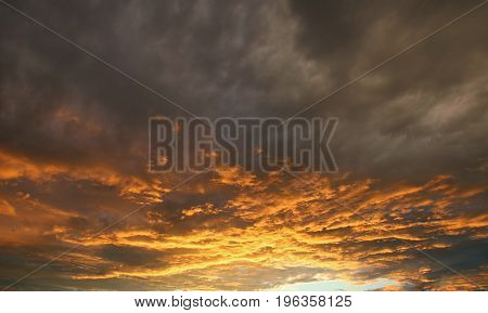 Sunset or sunrise with clouds light rays and other atmospheric effect