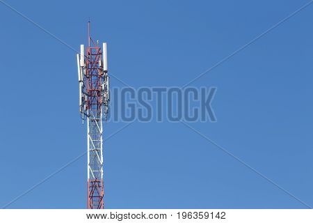 Cell site Telecommunications radio tower or mobile phone base station with atop the antenna.