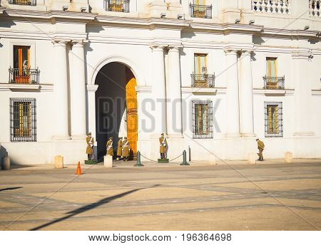 June 24, 2012, Santiago, Chile; La Moneda presidential palace with uniformed guards on duty around entrance of beautiful architectural landmark building Santiago Chile