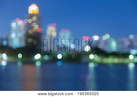 Beauty of twilight city blurred light over water lake abstract background