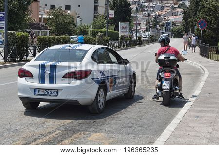 A Police Car Stopped A Motorcyclist