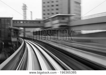 Train moving blurred motion into tunnel abstract background