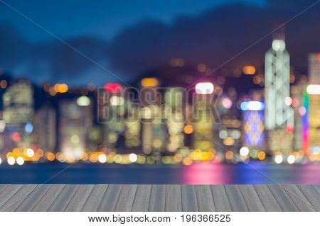 Opening wooden floor Hong Kong office building blurred bokeh light sea front abstract background