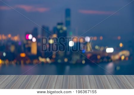 Aerial view opening wooden floor Hong Kong central business downtown blurred bokeh light abstract background