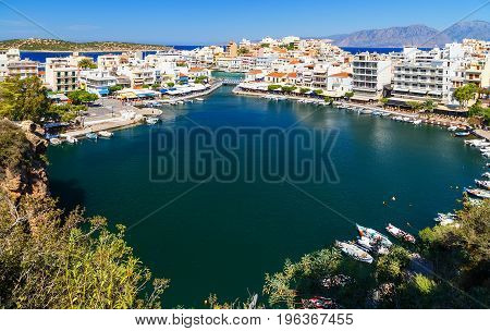Panorama of Agios Nikolaos or Ayios, Aghios town in Crete, Greece. Showing famous places: Lake, Marina, Bay