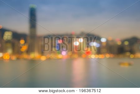 Hong kong blurred bokeh light over Victory bay after sunset abstract background