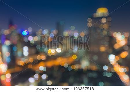 Beauty night blurred bokeh city light with twilight sky abstract background