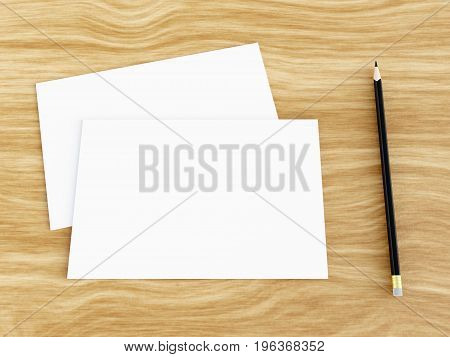 Blank white greeting card mockup with pencil on wooden table, angled top view, 3D rendering