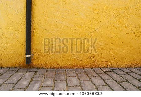 Yellow cement wall texture and grey brick floor use for background