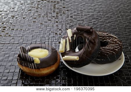 Chocolate Donut On A Black Tile
