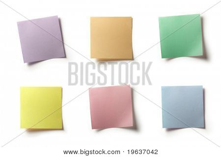 Full-size composite photo of various colored notes (pastel shades). Isolated on white background with light shadows.