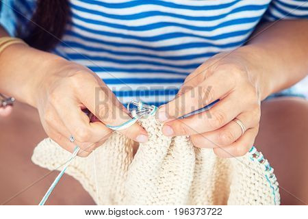 Woman In A Striped Sweater Knits