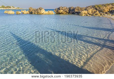 Sea colors .Apulia coast,Italy: Marina di Pulsano beach, Canne Bay (Taranto). Shadows on the shoreline. The coastline is characterized by a suggestive alternation of sandy coves and jagged cliffs overlooking a truly clear and crystalline sea (Italy).