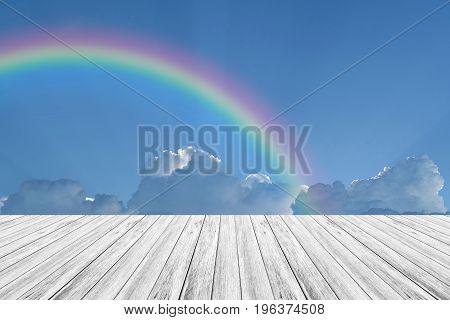 Wood Terrace And Blue Sky With Rainbow