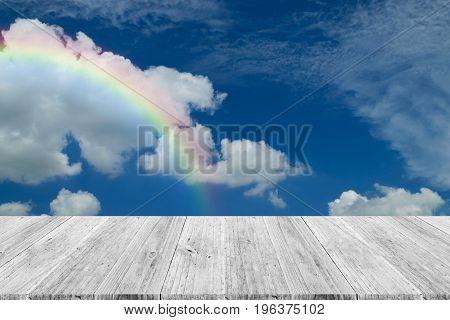 Blue Sky Cloud With Wood Terrace And Rainbow