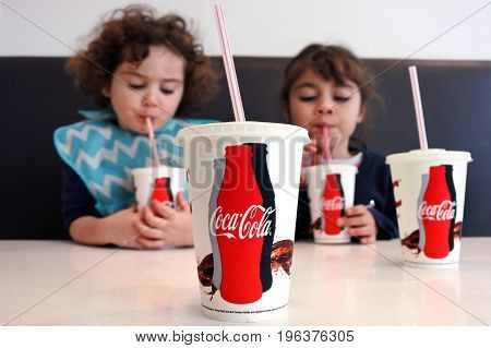Young Girls Drinking Coca Cola