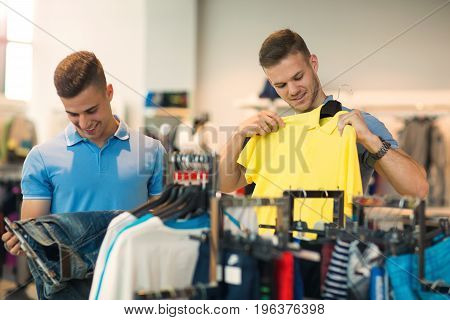 Two man deciding on new sportswear in sports store