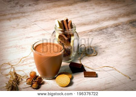 Hazelnut milk - chocolate milk and cookies on rustic wooden table