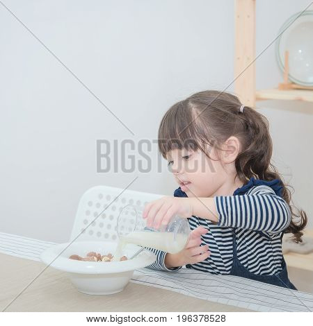 Happy Cute Little Girl Prepare Healthy Breakfast In The Morning. Photo Series Of Family, Kids And Ha