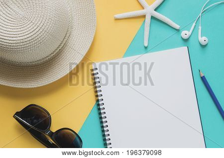Blank Notebook With Straw Hat, Sunglasses, Starfishes, Pencil, Earphone, On Yellow And Blue Backgrou