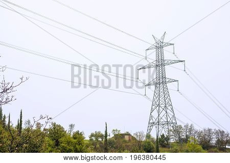 High voltage electric pylon and wires. Energy distribution concept.