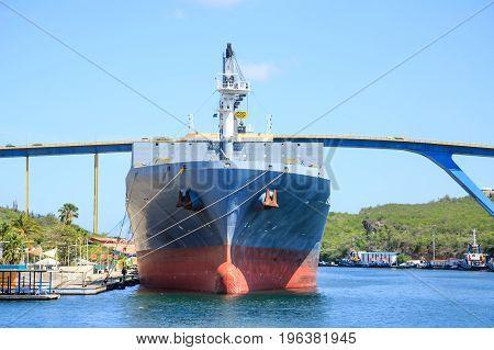 A Docked Massive Tanker Under Curacao Bridge