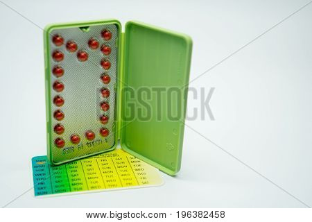 Contraceptive pills with modern package on white background