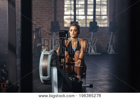 Athlete Exercising In Gym